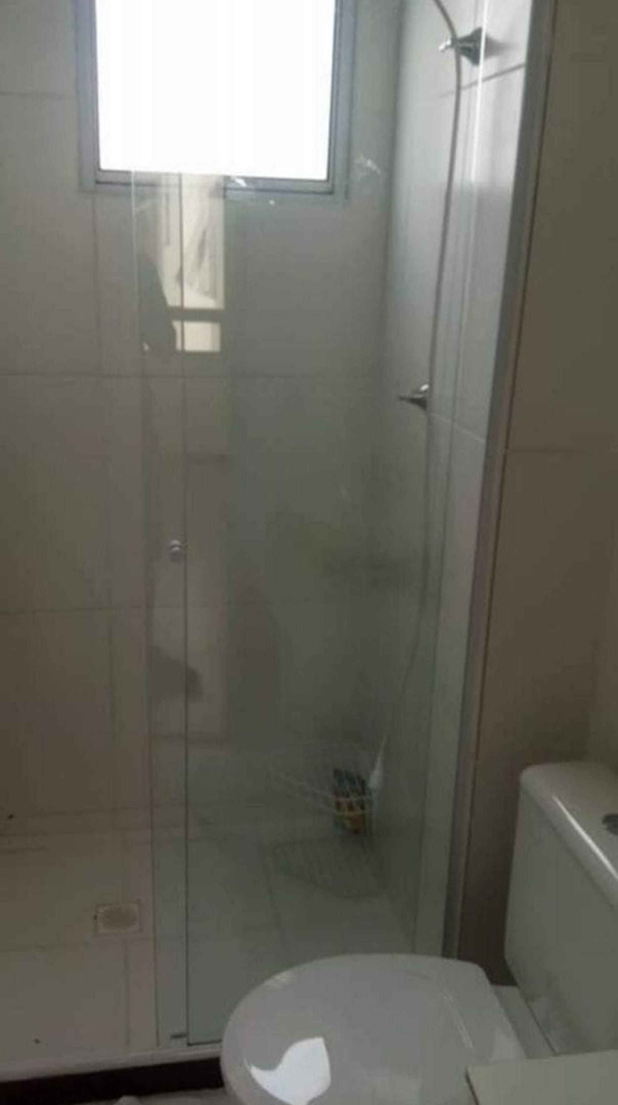 Foto de Corredor com vaso sanitário