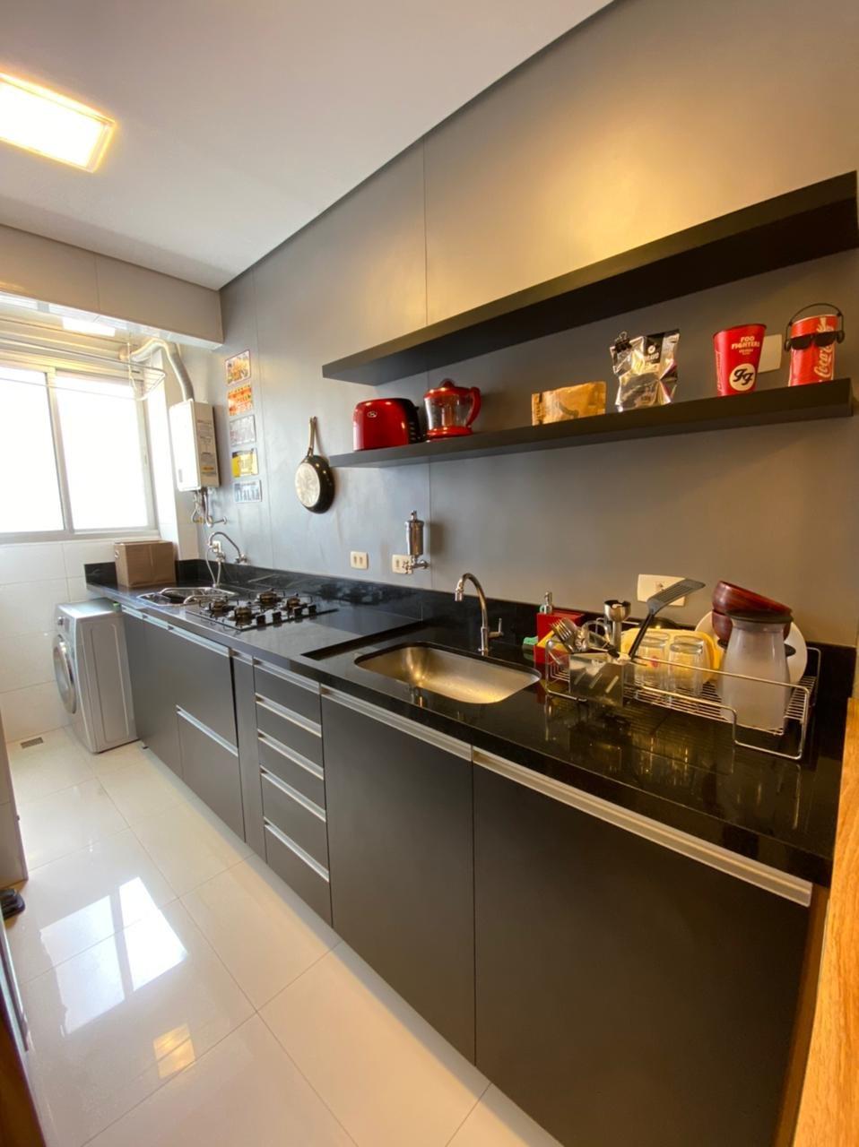 Foto de Cozinha com tigela, televisão, pia
