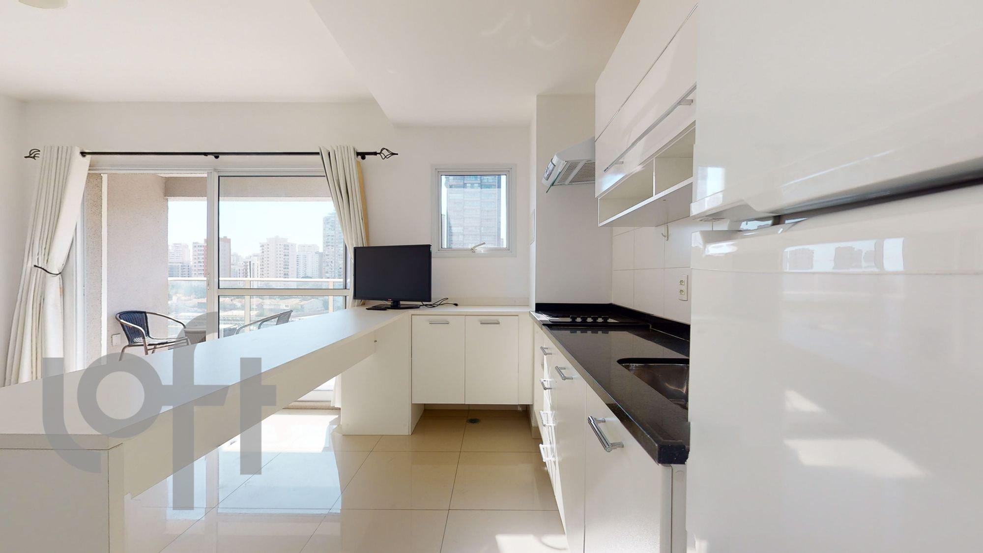 Foto de Cozinha com televisão